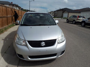 2010 Suzuki SX4 smooth and nice with two remote starters