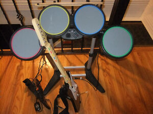 rockband set for ps3 comes with drums ,guitar and game, foot ped