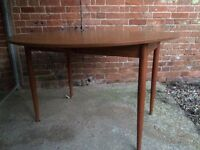 Round fold out dining table