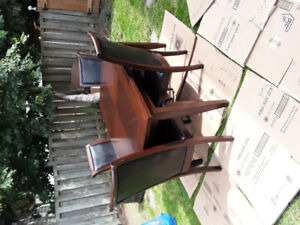 Table and four chairs plus extention obo