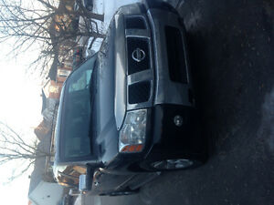 Black Nissan Armada low 4X4