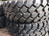"""46"""" Michelin XZL tires and rims"""