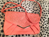 coral and gold clutch