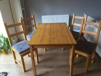 Ikea dinning table with 4 chairs