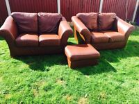 2x2 leather sofas by klaussner with storage poufee. Free local immediate delivery