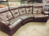 As new brown leather curved recliner sofa