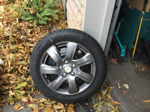 4 Bridgestone Blizzak winter tires - used half season
