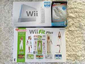 Nintendo Wii with Wii Fitness, controllers, and games