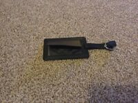 Genuine black leather luggage tag.