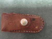 FOUND:  Pocket Knife in brown leather holder (strap broken)