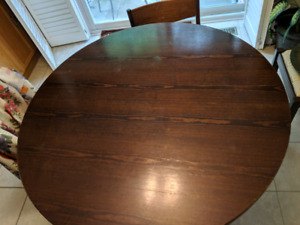 Round table with three chairs