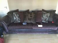 Leather and fabric like new condition settees 3 seater and 2 seater