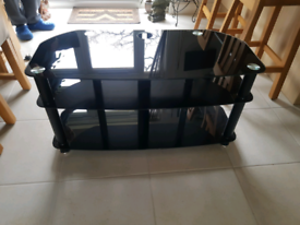 Black glass with silver trim TV stand