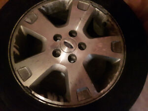 4 tires on aluminum Ford rims  17 inch