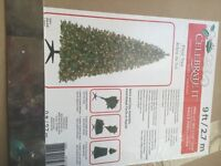 9ft.  Christmas tree and blue and white Christmas decorations