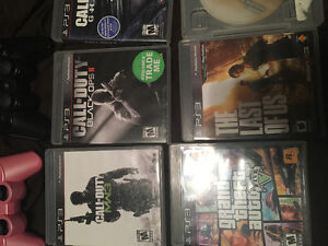 PS3 with two controllers and 14 games