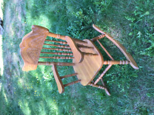 Child's sized hand carved rocking chair