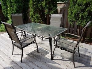Patio table and 6 chairs (only 4 shown in picture).