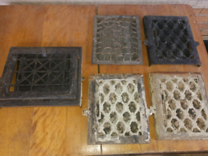 Antique iron wall grates.