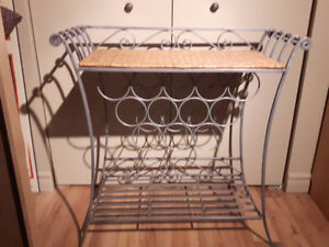 Etagere a vin en fer forge; Wine shelving unit in wrought iron.