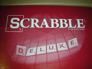 the scrabble deluxe as new never been played and dictionary