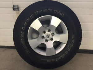Four Stock Nissan Pathfinder Rims and Tires
