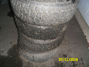 225/60r18 studded winter tires mounted GM rims