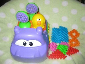 hippo toy with blocks, peek a boo block toy and monkey toy