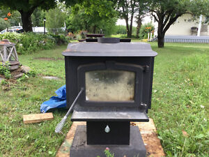 Air tight wood stove with blower