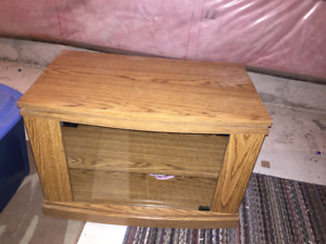 MUST SEE: T.V. STAND IN GREAT CONDITION FOR FREE