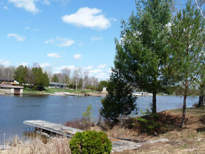 GORGEOUS PRIVATE 1 ACRE WATERFRONT LOT!  EXECUTIVE HOME!