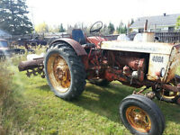 Belarus 400a tractor with heavy duty rotor tiller