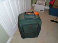 small green suitcase