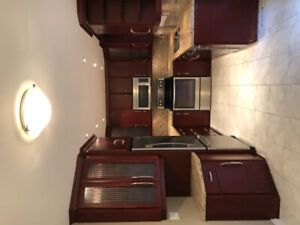 Kitchen with appliances included: refrigerator, stove, microwave