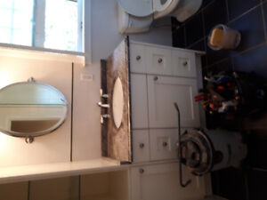 Granite countertop, taps and sink included