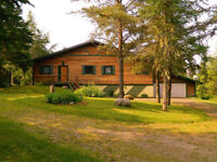 Exclusive Ranch Style Red Cedar R2000 Home With Acreage.