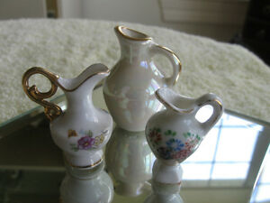 GROUP of THREE MINIATURE VINTAGE CHINA CREAMERS
