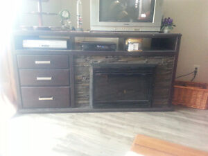 Entertainment unit with fireplace