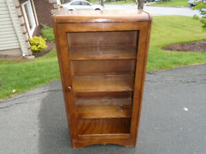Self enclosed wooden bookcase