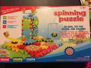 2 Boxes of Plastic Spinning Puzzles Gears- LIKE NEW! Kingston Kingston Area image 2