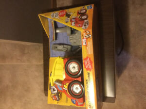 Tonka Chuck with race gear. Talks, age 3 and up. BRAND NEW