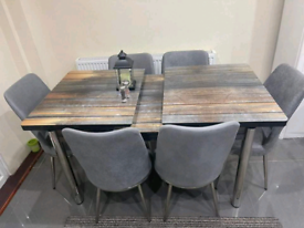 Stylish wooden extendable dining table with chairs