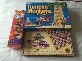Board game bundle- uno stacko, snakes and ladders, tumbling monkeys