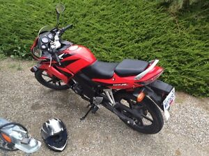 Red Honda CBR 125 with additional gear and maintanance items!
