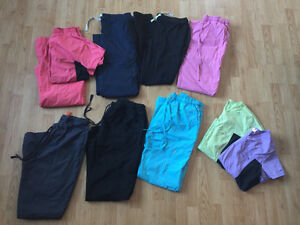 Mix of small, medium and large women's scrubs! Offer OBO