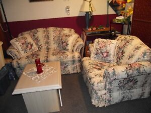 Beautiful love seat and matching chair with pillows