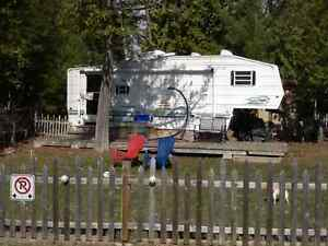 5th wheel camper on a waterfront site at White Lake