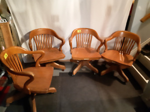 4 antique oak office chairs, swivel base. 1950 circa..