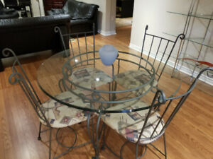 Round dining table Glass and heavy Iron with Backers rack