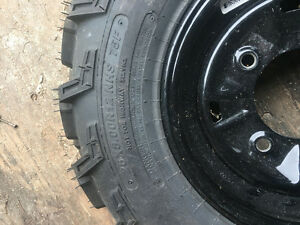 Brand new Polaris quad tires on rims
